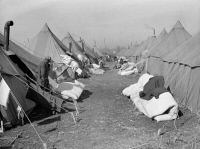 0325852 © Granger - Historical Picture ArchiveARKANSAS: REFUGEE CAMP.   Tents in the camp for black flood refugees in Forrest City, Arkansas. Photograph by Edwin Locke, March 1937.