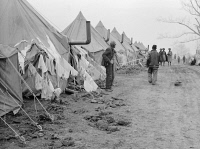 0325853 © Granger - Historical Picture ArchiveARKANSAS: REFUGEE CAMP.   Tents in the camp for black flood refugees in Forrest City, Arkansas. Photograph by Edwin Locke, February 1937.