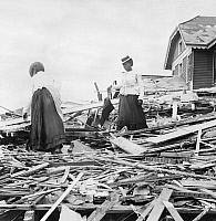 0130343 © Granger - Historical Picture ArchiveGALVESTON HURRICANE, 1900.   Two African American women standing among rubble where their home once stood, following the hurricane that devastated Galveston, Texas, 8-9 September 1900.
