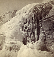 0129978 © Granger - Historical Picture ArchiveYELLOWSTONE PARK: RIDGE.   Fissured Ridge covered in snow in Mammoth Hot Springs on Gardiner's River, Yellowstone National Park, Wyoming. Stereograph, c1870-1880.