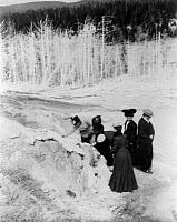 0621240 © Granger - Historical Picture ArchiveYELLOWSTONE: TOURISM, 1903.   A group of tourists exploring land formations at Yellowstone National Park. Photograph by Frances Benjamin Johnston, 1903.
