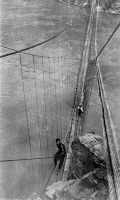 0621262 © Granger - Historical Picture ArchiveGRAND CANYON: BRIDGE, 1928.   Rigger working on the Kaibab Trail Suspension Bridge spanning the Colorado River, Grand Canyon, Arizona. Photograph, 1928.