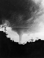 0132651 © Granger - Historical Picture ArchiveTORNADO.   A tornado funnel photographed along a road somewhere in the United States. Photograph, mid 20th century.