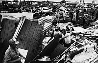 0183580 © Granger - Historical Picture ArchiveFLORIDA: TORNADO, 1974.   Tornado victims search through the rubble of the Citrus Park mobile home community near Tampa, Florida, after a tornado struck in February 1974.