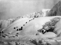 0113427 © Granger - Historical Picture ArchiveNIAGARA FALLS.   People climbing Niagara Falls in the winter. Photographed 20th century.