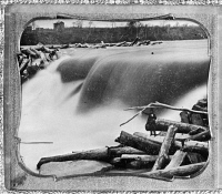 0165527 © Granger - Historical Picture ArchiveST. ANTHONY FALLS, c1850.   A view of the Falls of St. Anthony on the Mississippi River in Minneapolis, Minnesota, partly jammed with logs from a sawmill upstream; Ard Godfrey, who constructed the sawmill in 1849, stands on a log in the foreground. Daguerreotype, c1852, by Tallmadge Elwell.