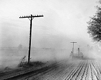 0127603 © Granger - Historical Picture ArchiveDUST BOWL, c1936.   Soil from a drought-stricken cornfield in Michigan being blown across a road by 50-mile per hour winds, c1936.