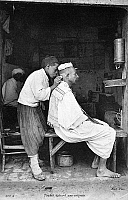 0090764 © Granger - Historical Picture ArchiveNORTH AFRICA: BLEEDING.   A North African barber bleeding a patient. Undated French photograph.