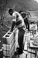 0176061 © Granger - Historical Picture ArchiveJOB CORPS VOLUNTEERS, c1970.   Construction workers from the Oconaluftee Job Corps Center in the town of Cherokee, Swain County, North Carolina, helping to build a community center to be used by members of the Eastern Band of Cherokee residing in the area. Photograph by Paul Conklin, c1970.
