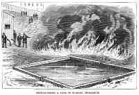 0354249 © Granger - Historical Picture ArchiveFIREFIGHTING, 1876.   Demonstration of extinguising a tank of burning petroleum, at 59th Street and 11th Avenue in Manhattan, using the Hastings System for fighting fires. Wood engraving, American, 1876.
