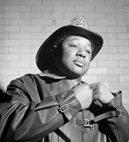 0408694 © Granger - Historical Picture ArchiveNYC: FIREMAN, 1942.   Portrait of an unidentified member of the FDNY in New York City. Photograph, c1942.