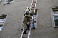0621193 © Granger - Historical Picture ArchiveFIREFIGHTING, 2016.   A firefighter ascending a ladder in Berlin, Germany. Photograph by T. Seeliger, 21 August 2016. Full Credit: ullstein bild - snapshot-photography / T.Seeliger / Granger, NYC. All Rights Reserved.