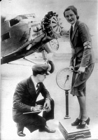 0525844 © Granger - Historical Picture ArchiveSTEWARDESS, 1934.   A United Airlines stewardess being weighed. Photograph, c1935.