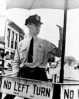 0118750 © Granger - Historical Picture ArchiveTRAFFIC COP, 1936.   A traffic cop directing traffic, Washington, D.C. Photographed in 1936.