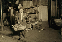 0131968 © Granger - Historical Picture ArchiveCELERY VENDOR, 1912.   A boy selling celery at the Center Market in Washington, D.C. Photograph by Lewis Hine, April 1912.