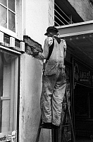 0121253 © Granger - Historical Picture ArchiveTEXAS: WORKMAN, 1939.   A workman plastering a wall of a movie theater in Waco, Texas. Photograph by Russell Lee, November 1939.