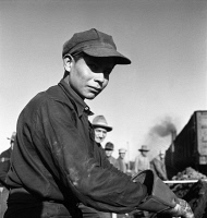 0324235 © Granger - Historical Picture ArchiveKANSAS: RAILROAD WORKER.   A young Navajo laborer working in the Atchison, Topeka and Santa Fe Railroad yard in Winslow, Arizona. Photograph by Jack Delano, 1943.