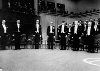 0123882 © Granger - Historical Picture ArchiveNOBEL PRIZE WINNNERS, 1976.   The winners, all American, at the ceremony in the concert hall of Stockholm, Sweden. From left: Burton Richter (Physics); Samuel Ting (Physics); William Lipscomb (Chemistry); Baruch Blumberg (Medicine); Carleton Gajdusek (Medicine); Saul Bellow (Literature); and Milton Friedman (Economics).