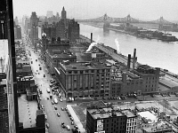 0100921 © Granger - Historical Picture ArchiveUNITED NATIONS: SITE, 1946.   Looking north along First Avenue from Tudor City at 41st Street, on the site of the future headquarters of the United Nations, December 1946. The Queensborough Bridge is in the background.