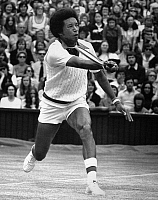 0169622 © Granger - Historical Picture ArchiveARTHUR ASHE (1943-1993).   American tennis player. Photographed during his match against Jimmy Connors in the men's singles final at Wimbledon, won by Ashe in four sets, 5 July 1975.