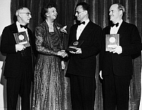 0170496 © Granger - Historical Picture ArchiveNELSON ALGREN (1909-1981).   American writer. Being congratulated by former first lady Eleanor Roosevelt after being presented with the National Book Award for fiction at the Waldorf-Astoria Hotel in New York City, 16 March 1950, with fellow award winners William Carlos Williams (for poetry, left) and Ralph L. Rusk (for nonfiction, right).