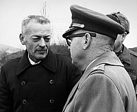 0175877 © Granger - Historical Picture ArchiveLLOYD M. BUCHER (1927-2004).   American naval officer. Bucher (left), the commander of the U.S.S. 'Pueblo,' speaking with a colonel of the United Nations Command after crossing the bridge into South Korea at Panmunjom, 22 December 1968, following the release of himself and his crew by North Korea, where they had been held captive for the previous 11 months.
