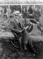 0621369 © Granger - Historical Picture ArchiveLUTHER BURBANK (1849-1926).   American horticulturist. In a wicker rocking chair, backed by a field of cactus. Photograph, c1895.