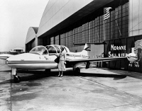 0621585 © Granger - Historical Picture ArchiveOLIVE ANN BEECH (1903-1993).   American businesswoman and cofounder of the Beech Aircraft Company. Next to a Morane-Saulnier 760 at an air hangar in Westchester County Airport, White Plains, New York. Photograph, 1955.