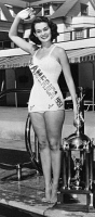 0622898 © Granger - Historical Picture ArchiveYOLANDE BETBEZE (1928-2016).   American opera singer and civil rights activist. As Miss America of 1951, posing with her trophy. Photograph, 1950.