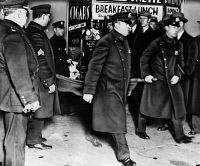 0621565 © Granger - Historical Picture ArchiveVINCENT 'MAD DOG' COLL   (1908-1932). Irish mobster and hitman. New York City police officers removing Coll's body from the drug store where he was gunned down. Photograph, 1932.