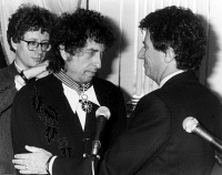 0621526 © Granger - Historical Picture ArchiveBOB DYLAN (1941- ).  American musician. Being made a Knight of the Order of Arts and Letters by French Minister of Culture Jack Lang in Paris, France. Photograph, 30 January 1990. Full Credit: AGIP - Rue des Archives / Granger, NYC. All Rights Reserved.