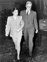 0622627 © Granger - Historical Picture ArchiveIVA TOGURI D'AQUINO   (1916-2006). American typist and broadcaster who participated in radio propaganda in wartime Japan; so-called 'Tokyo Rose.' Led by U.S. Deputy Marshall Herbert Cole from Federal Court in San Francisco. Photograph, 1949.