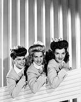 0031364 © Granger - Historical Picture ArchiveTHE ANDREWS SISTERS.   American entertainers. In a scene from 'Follow the Boys,' 1944, with (from left) Maxene (1916-1995), Patty (1918-2013), and Laverne (1913-1967).