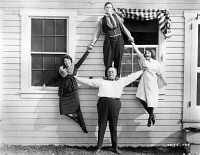 0053562 © Granger - Historical Picture ArchiveROSCOE 'FATTY' ARBUCKLE   (1887-1933). American cinema actor (bottom) with Buster Keaton (top).