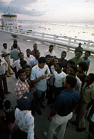 0167450 © Granger - Historical Picture ArchiveMUHAMMAD ALI (1942-2016).   Né Cassius Clay. American heavyweight boxer. Signing an autograph amidst a crowd of admirers on the shore of the Congo River at Kinshasa, Zaire, September 1974, prior to his championship fight agasint George Foreman. The hospital ship 'Mama Mobutu' is moored in the background at left.