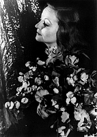 0124759 © Granger - Historical Picture ArchiveTALLULAH BANKHEAD   (1903-1968). American actress. Photographed holding a bouquet of flowers, by Carl Van Vechten, 1934.