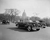 0125315 © Granger - Historical Picture ArchiveFULGENCIO BATISTA (1901-1973).   Cuban soldier and dictator. Batista with U.S. Army Chief of Staff, General Malin Craig, in a car passing the Capitol building in Washington, D.C., 10 November 1938.