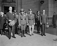 0125316 © Granger - Historical Picture ArchiveFULGENCIO BATISTA(1901-1973).   Cuban soldier and dictator, at Union Station during a visit to Washington, D.C., 10 November 1938. Front row, left to right: Undersecretary of State, Sumner Wells; Batista; General Malin Craig; and Cuban ambassador Dr. Pedro Fraga.