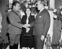 0125317 © Granger - Historical Picture ArchiveFULGENCIO BATISTA (1901-1973).   Cuban soldier and dictator. Batista (left) shaking hands with the Cuban ambassador to the United States, Dr. Pedro Fraga, at the Cuban embassy in Washington, D.C., 10 November 1938. Between them in Batista's wife, Elisa Godinez-Gómez.