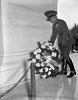 0125320 © Granger - Historical Picture ArchiveFULGENCIO BATISTA (1901-1973).   Cuban soldier and dictator, placing a wreath at the Tomb of the Unknown Soldier at Arlington National Cemetery in Virginia, 12 November 1938.