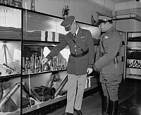 0125321 © Granger - Historical Picture ArchiveFULGENCIO BATISTA (1901-1973).   Cuban soldier and dictator. U.S. Army Chief of Staff Malin Craig showing Batista various types of bullets and ammunition at the World War Museum in Washington, D.C., 12 November 1938.
