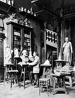 0106411 © Granger - Historical Picture ArchiveFREDERIC-AUGUSTE BARTHOLDI   (1834-1904). French sculptor. Photographed in his studio surrounded by some of his projects, including the Statue of Liberty at left, c1870.