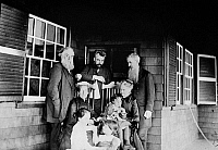 0117083 © Granger - Historical Picture ArchiveALEXANDER GRAHAM BELL   (1847-1922). American (Scottish-born) teacher and inventor. Photographed with his wife, daughters, Mr. and Mrs. Alexander Melville Bell, Mr. and Mrs. Gardiner Greene Hubbard on a porch at Manchester-by-the-Sea, Massachusetts, 1885.