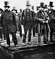 0100037 © Granger - Historical Picture ArchiveISAMBARD KINGDOM BRUNEL   (1806-1859). English civil engineer and naval architect. From left: John Scott-Russell, Henry Wakefield, Isambard K. Brunel and Lord Derby awaiting an attempt to launch 'The Great Eastern,' 1857.