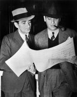 0053327 © Granger - Historical Picture ArchiveIRVING BERLIN (1888-1989).  Orig. Israel Baline. American songwriter. With director Mark Sandrich, studying the score of