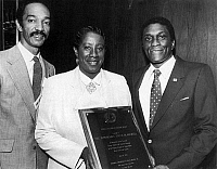 0071033 © Granger - Historical Picture ArchiveUNITA BLACKWELL (1933- ).   American civil rights activist and politician. Photographed at the National Conference of Black Mayors convention, St. Louis, Missouri, 1984, being presented with the Fannie Lou Hamer award by mayors Riley Owens of Centreville, Illinois (left) and Johnny Ford of Tuskegee, Alabama (right).