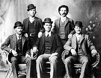 0032465 © Granger - Historical Picture ArchiveCASSIDY AND LONGBAUGH.  Butch Cassidy (1866-?), alias of Robert Leroy Parker, American desperado, and Harry Longbaugh (1867-?), known as the Sundance Kid, American desperado. Cassidy (seated far right) and Longbaugh (seated far left) with members of their 'Wild Bunch,' photographed at Fort Worth, Texas, in 1901.