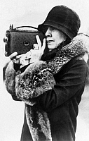 0126380 © Granger - Historical Picture ArchiveGRACE ANNA COOLIDGE   (1879-1957). Wife of president Calvin Coolidge. Taking a picture with a camera, 1929.