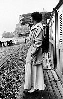 0107300 © Granger - Historical Picture ArchiveGABRIELLE 'COCO' CHANEL   (1883-1971). French fashion designer. Photographed on the beach in Etretat, Normandy, early 20th century. In the background is the cliff, Falaise d'Amont.