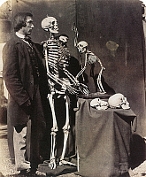 0117267 © Granger - Historical Picture ArchiveREGINALD SOUTHEY (1835-1899).   English physician. Posed with the skeletons and skulls of a human and an ape. Photograph by Charles Lutwidge Dodson (Lewis Carroll), 1857.